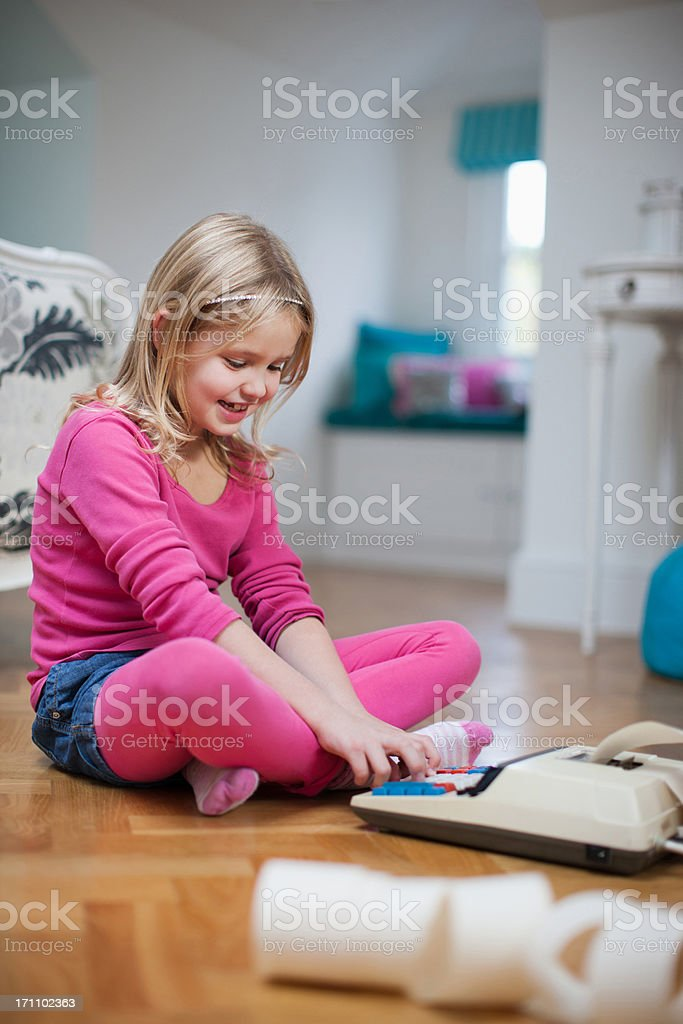 Girl looking at adding machine tape royalty-free stock photo
