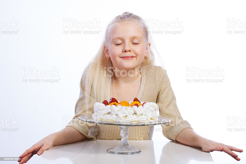 Girl looking at cake stock photo