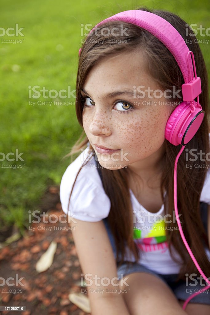 Girl Looking at Camera with Headphones royalty-free stock photo