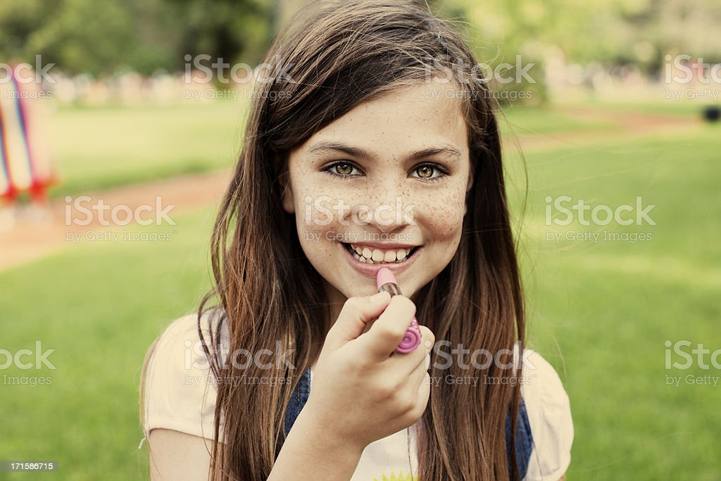 Girl Looking at Camera with Lipstick royalty-free stock photo