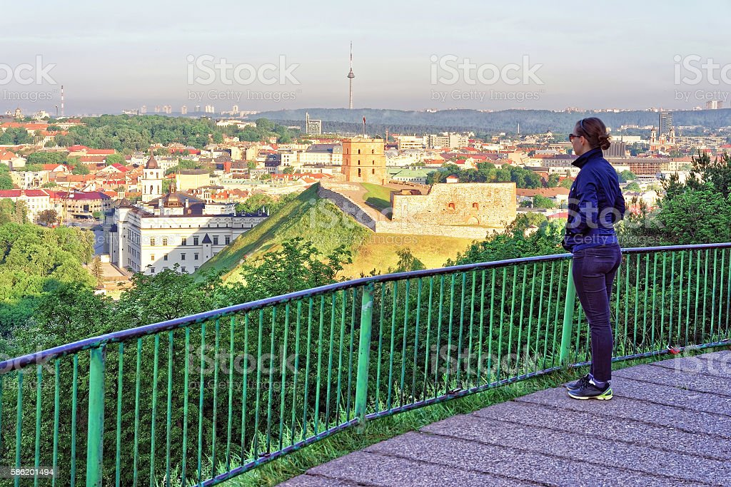 Girl looking at Gediminas Tower and Lower Castle of Vilnius stock photo