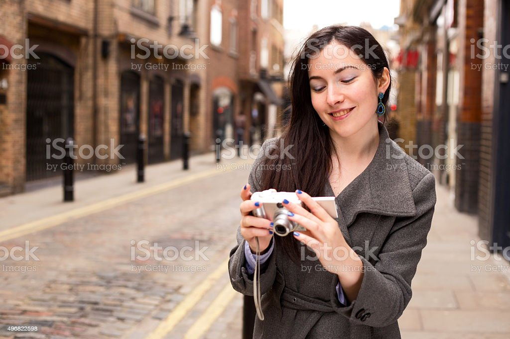 girl looking at her photos royalty-free stock photo