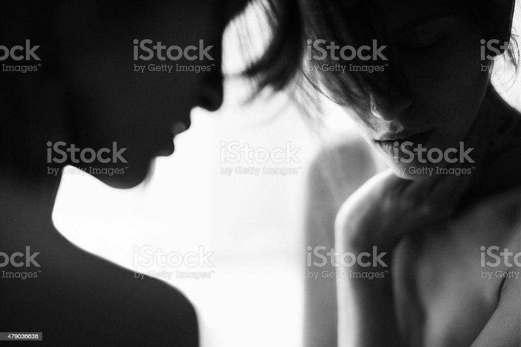 Girl looking at her reflection in the mirror stock photo