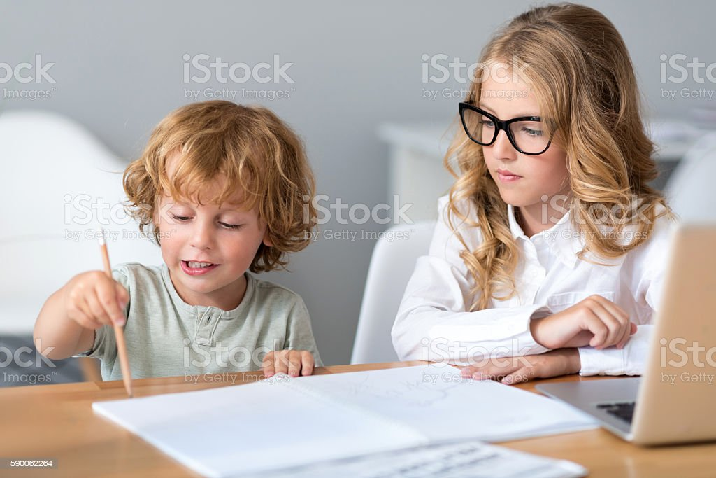 Girl looking at little boy stock photo