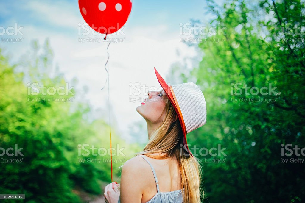 Girl looking at the balloon stock photo