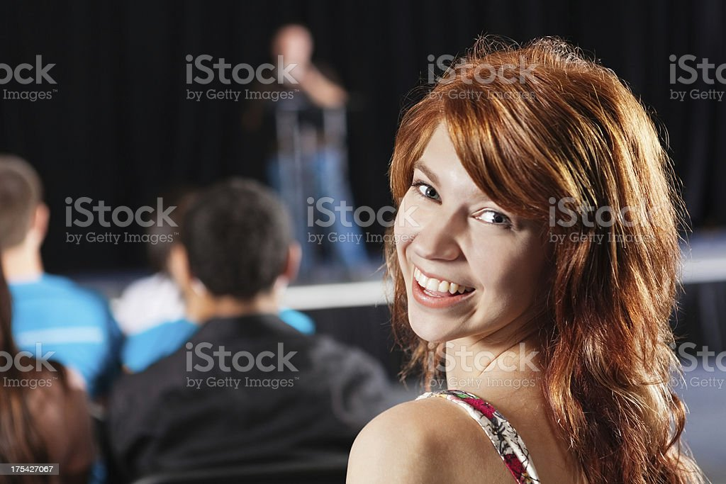 Girl looking back and smiling during school event royalty-free stock photo