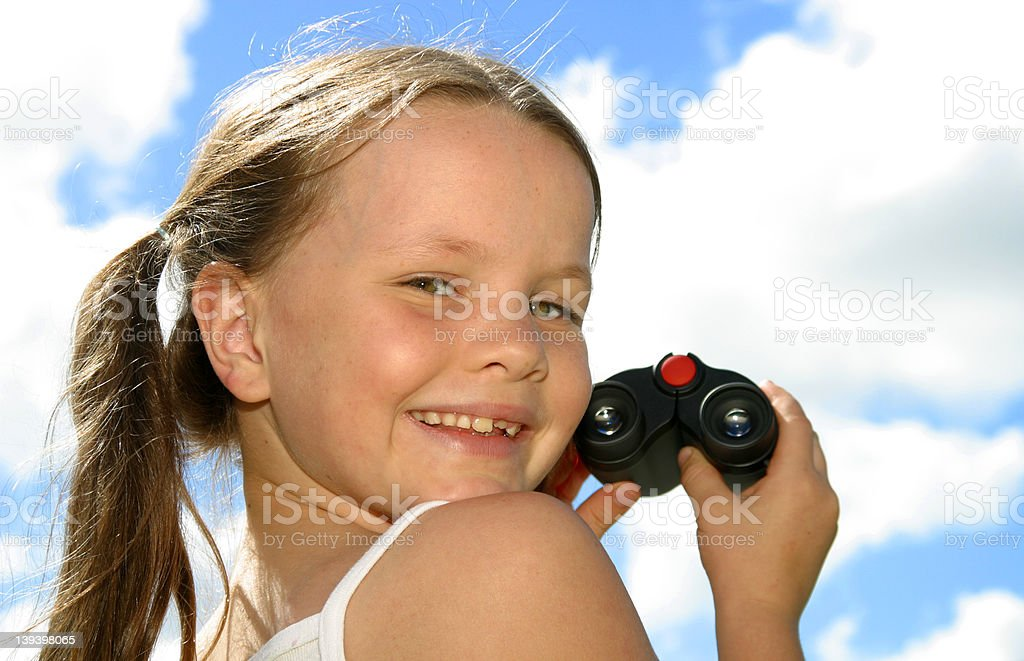 Girl Looking Back From Binoculars royalty-free stock photo