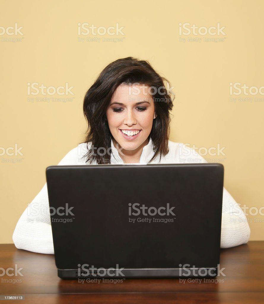 Girl Looking Down At Her Laptop royalty-free stock photo