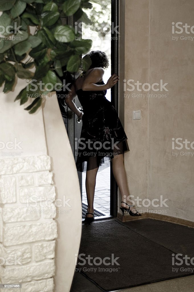 Girl looking for a guests royalty-free stock photo