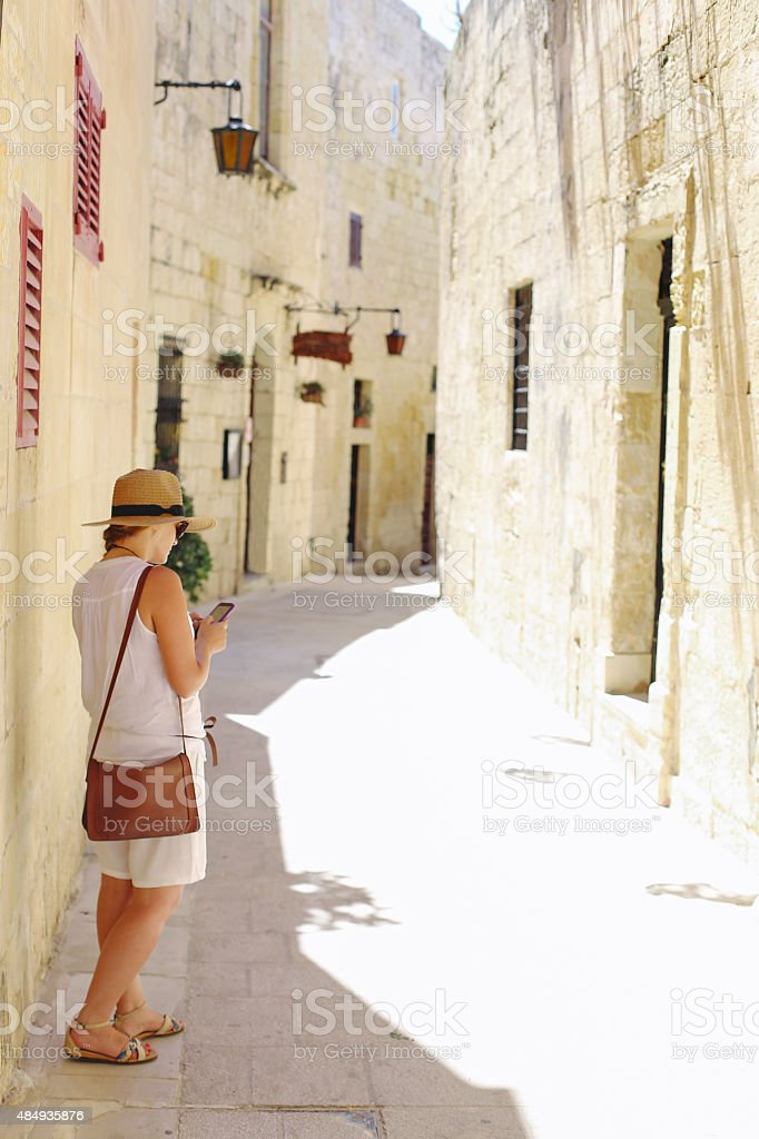 Girl looking for directions on phone map stock photo