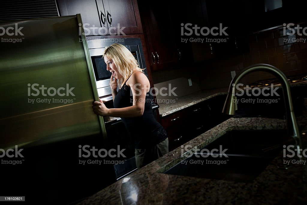 Girl looking for Midnight snack royalty-free stock photo