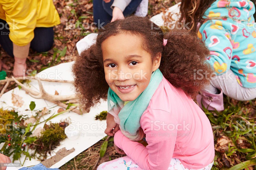 Girl Looking For Minibeasts At Activity Centre stock photo