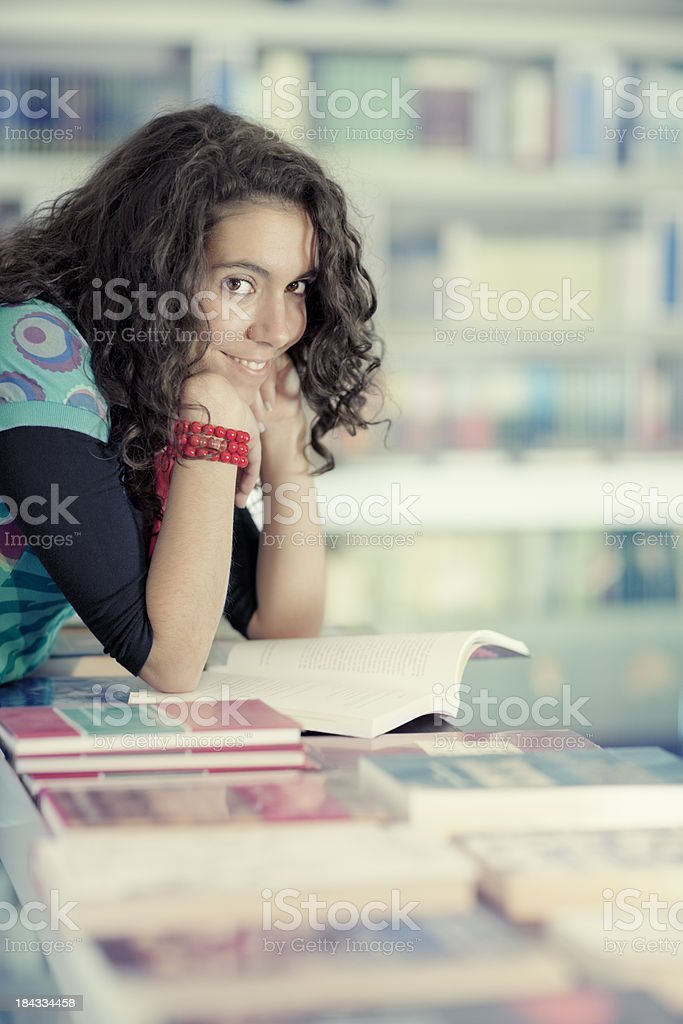 girl looking for the right book in  bookstore stock photo