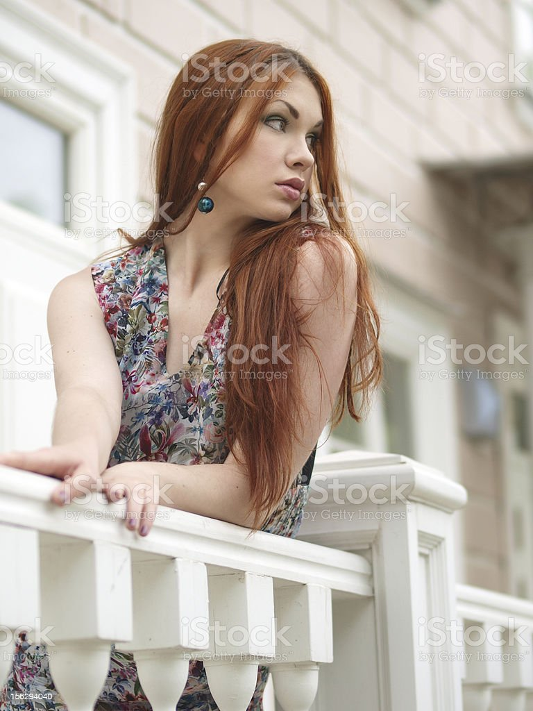 Girl looking from porch royalty-free stock photo