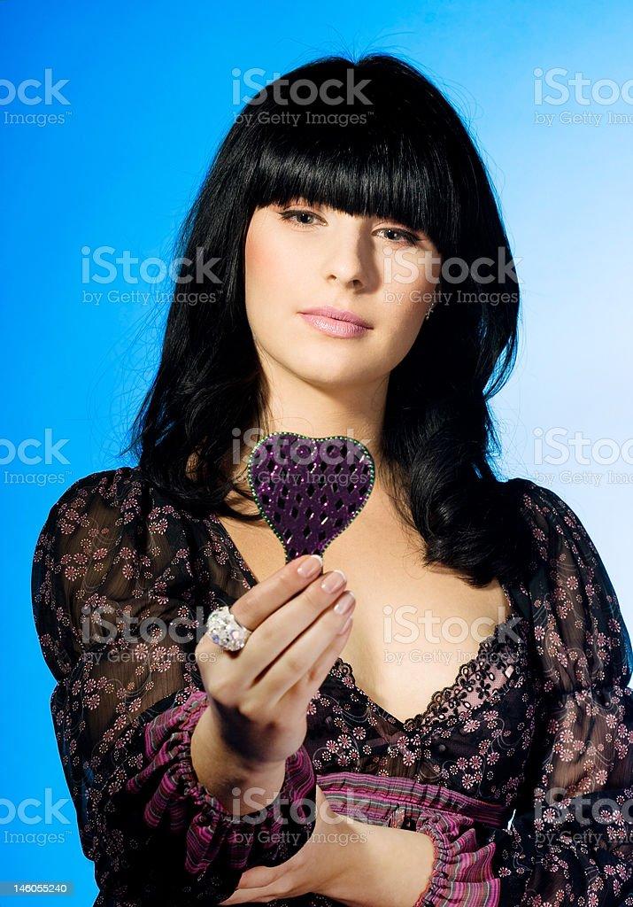 Menina olhando para um espelho foto de stock royalty-free