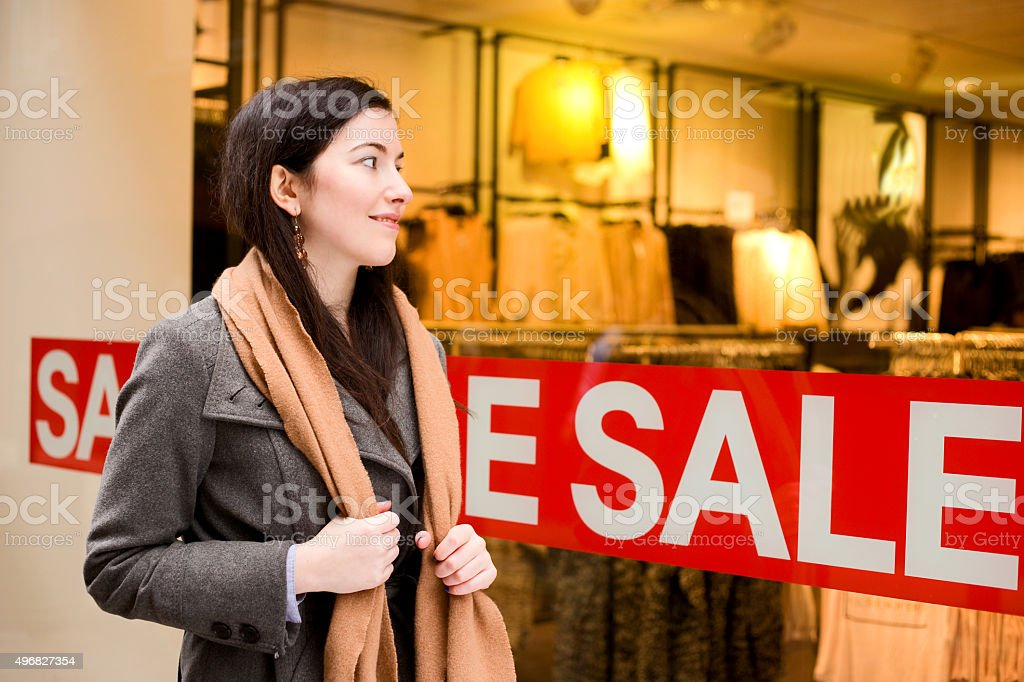 girl looking in shop window royalty-free stock photo