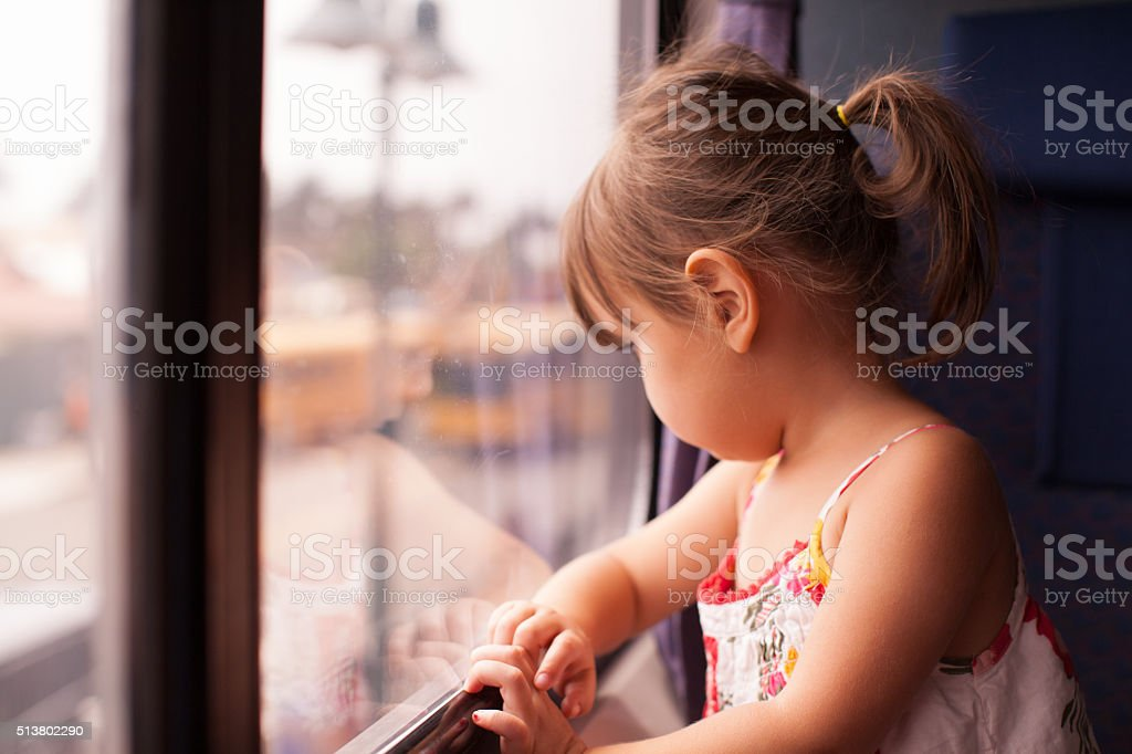 Girl Looking Out of Train Window stock photo