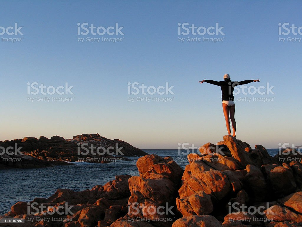 Girl looking out over the Indian Ocean in Western Australia stock photo