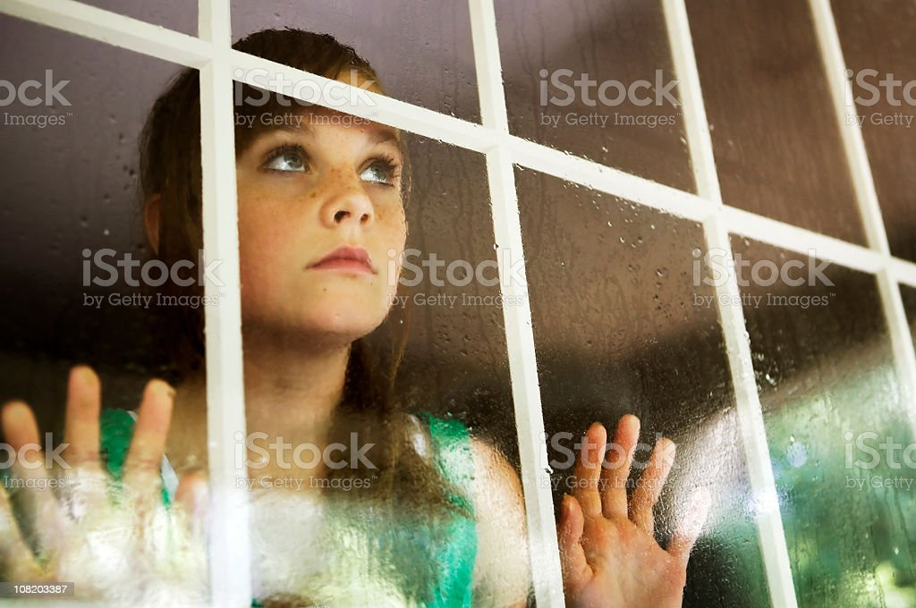 Girl Looking Out Window royalty-free stock photo