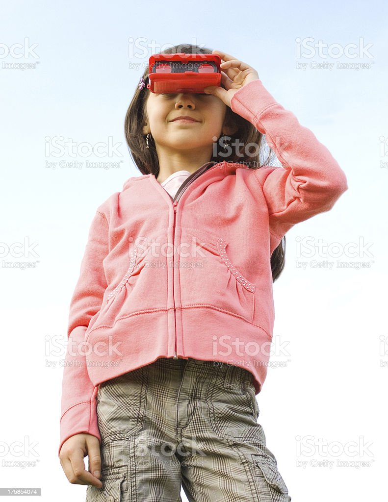 Girl looking though her binoculars royalty-free stock photo