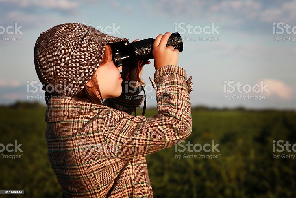 Girl looking through binoculars royalty-free stock photo