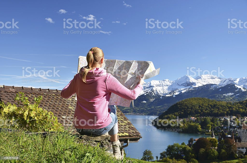 Girl looking to the map. Switzerland stock photo