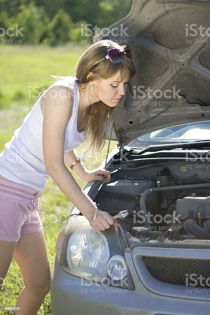 girl looking under the hood royalty-free stock photo