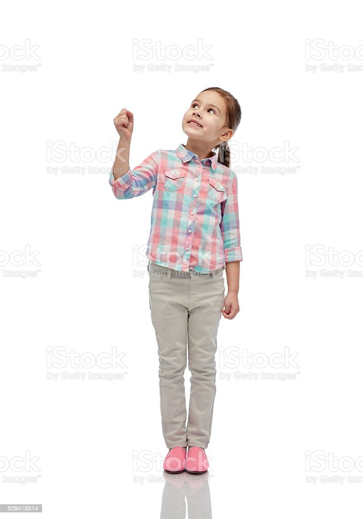 girl looking up and holding something invisible stock photo