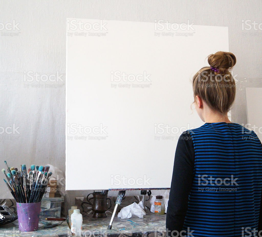 girl looks at a large canvas stock photo