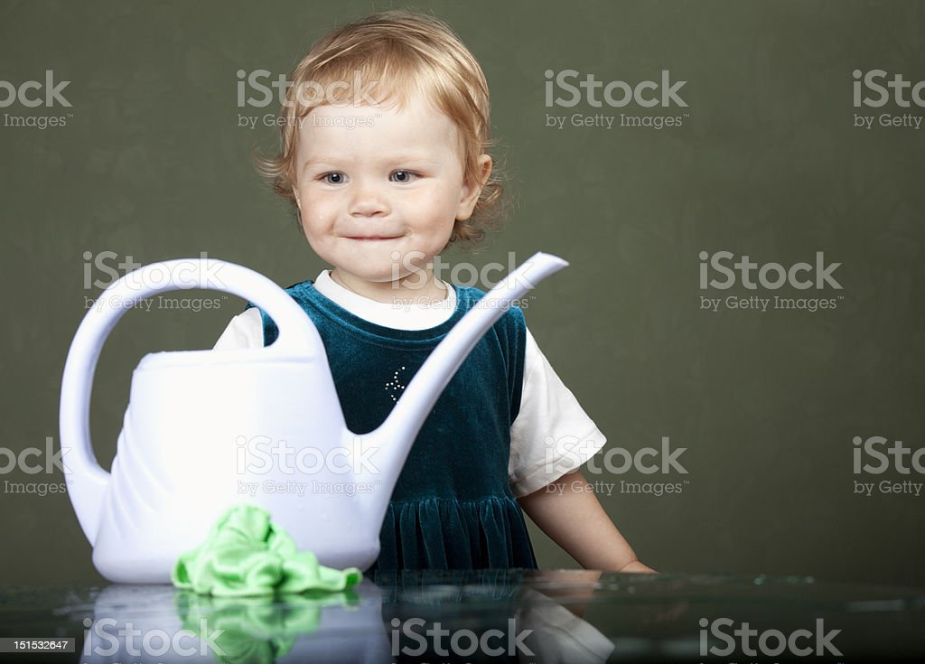girl looks at a watering stock photo