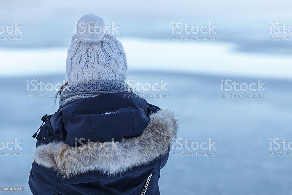 Girl Looks at Winter Lake stock photo