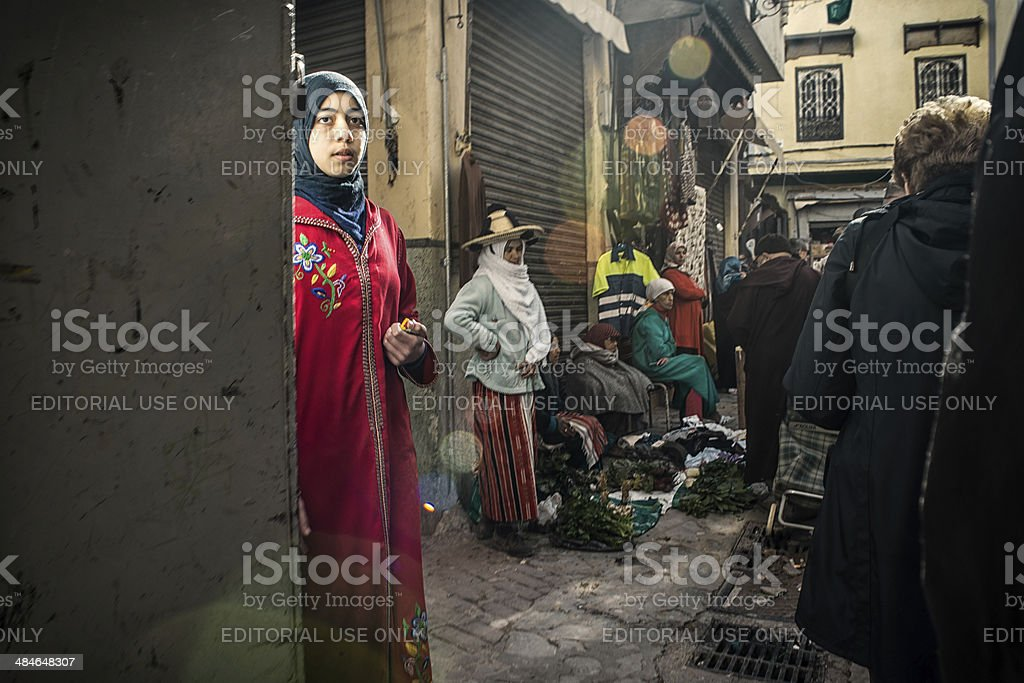 Girl looks nowhere in the crowdy casbah royalty-free stock photo