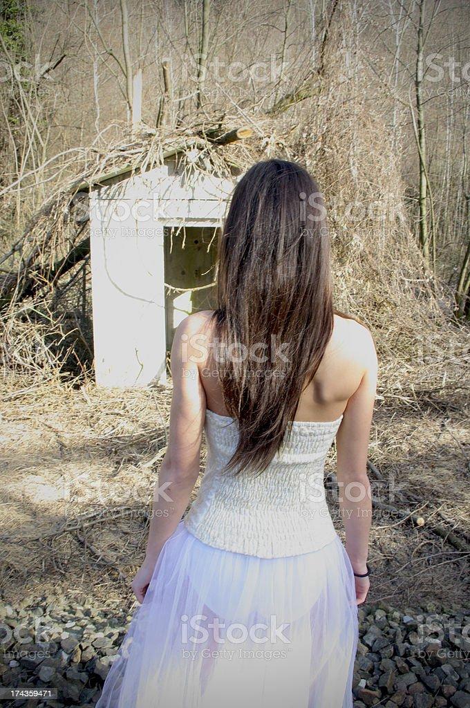 Girl looks terrifying landscape stock photo