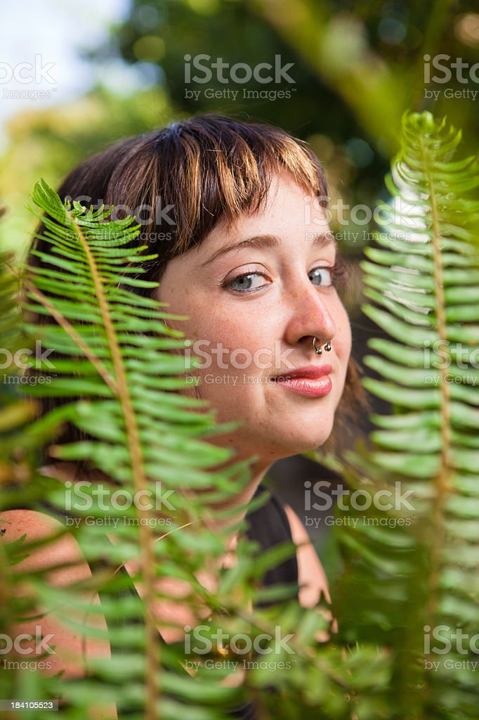 Girl lost in a Garden of Ferns royalty-free stock photo