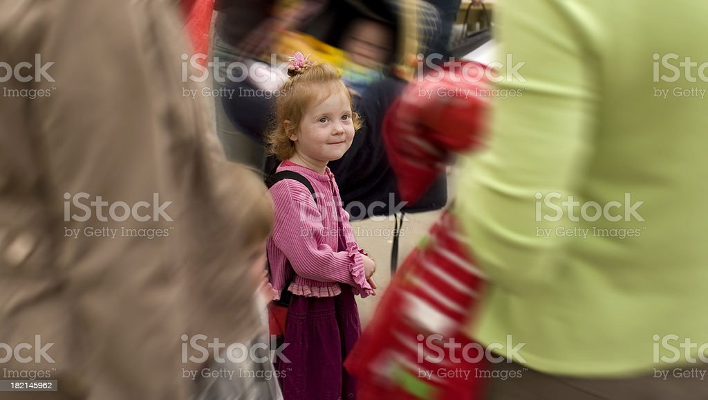 girl lost in crowd on first day at school stock photo