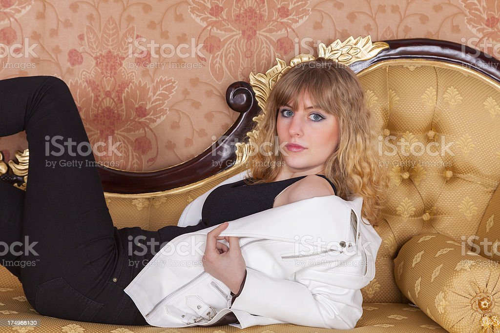 Girl Lounging On A Chaise Longue royalty-free stock photo