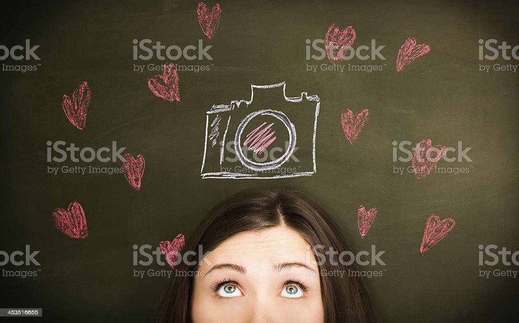 Girl loves  a photo camera royalty-free stock photo