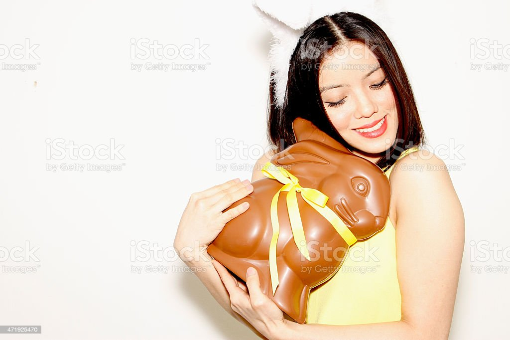 Girl loves Easter bunny Chocolate stock photo