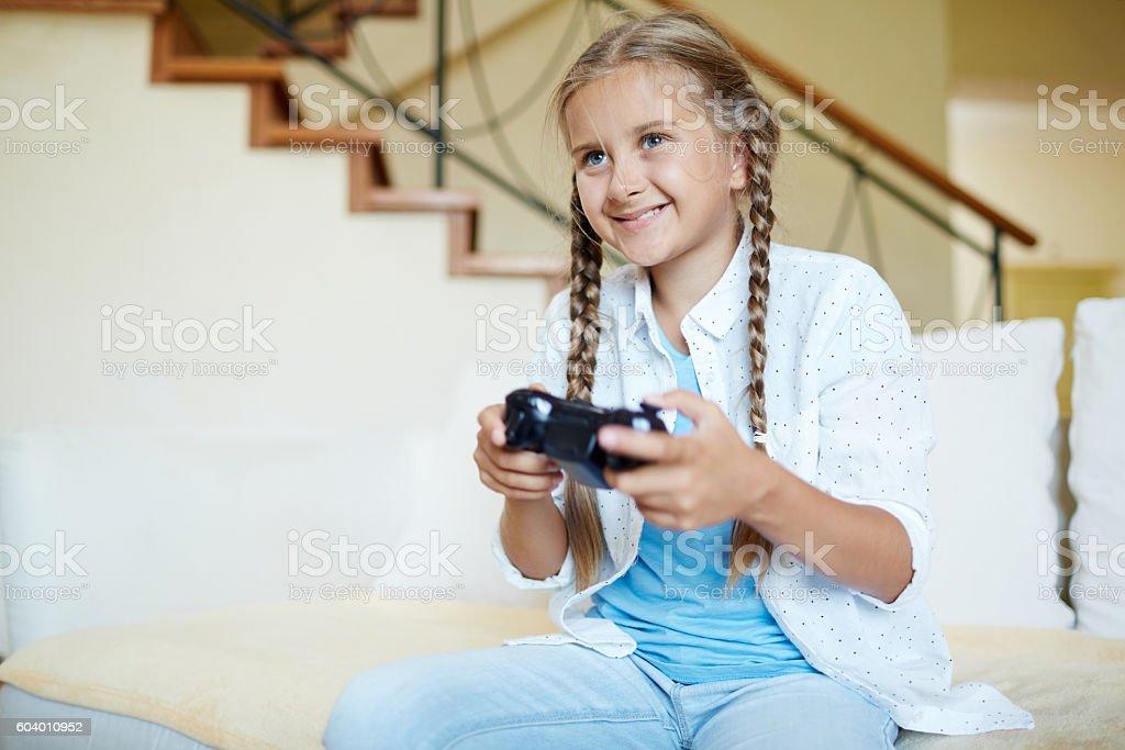 Girl loves video game stock photo