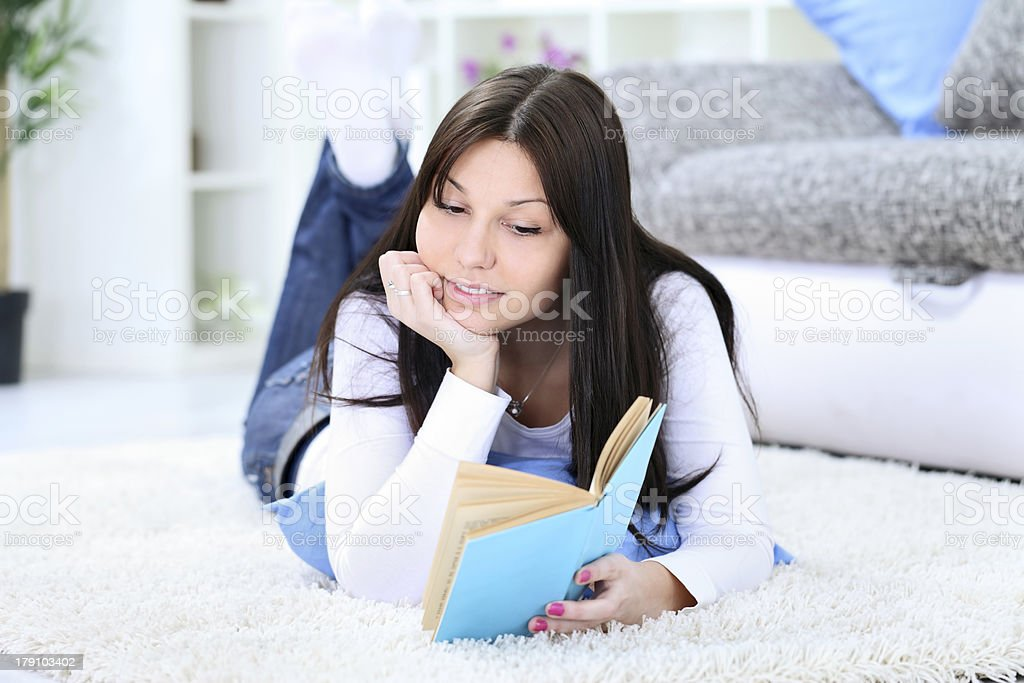Girl lying and reading book royalty-free stock photo