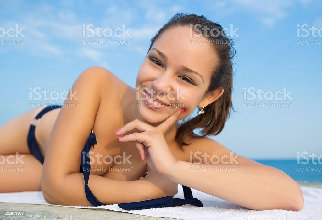 Girl lying down on open air stock photo