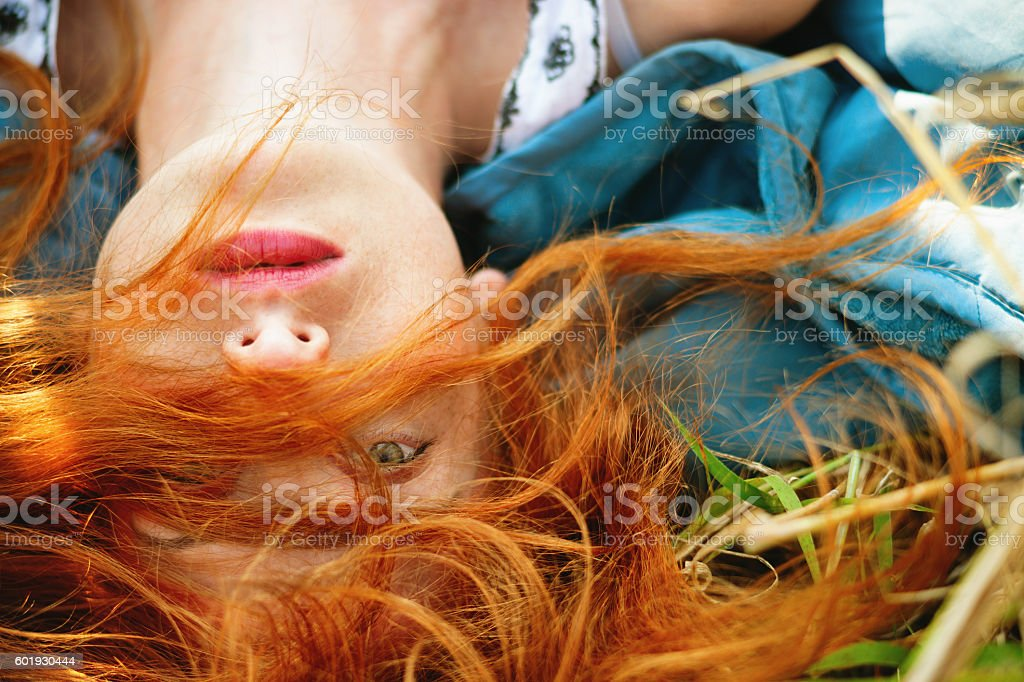 Girl lying in a meadow stock photo