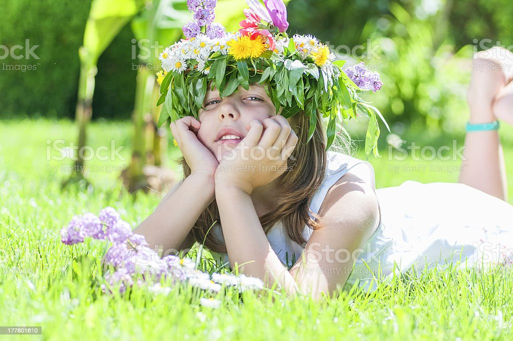 girl  lying in the grass royalty-free stock photo