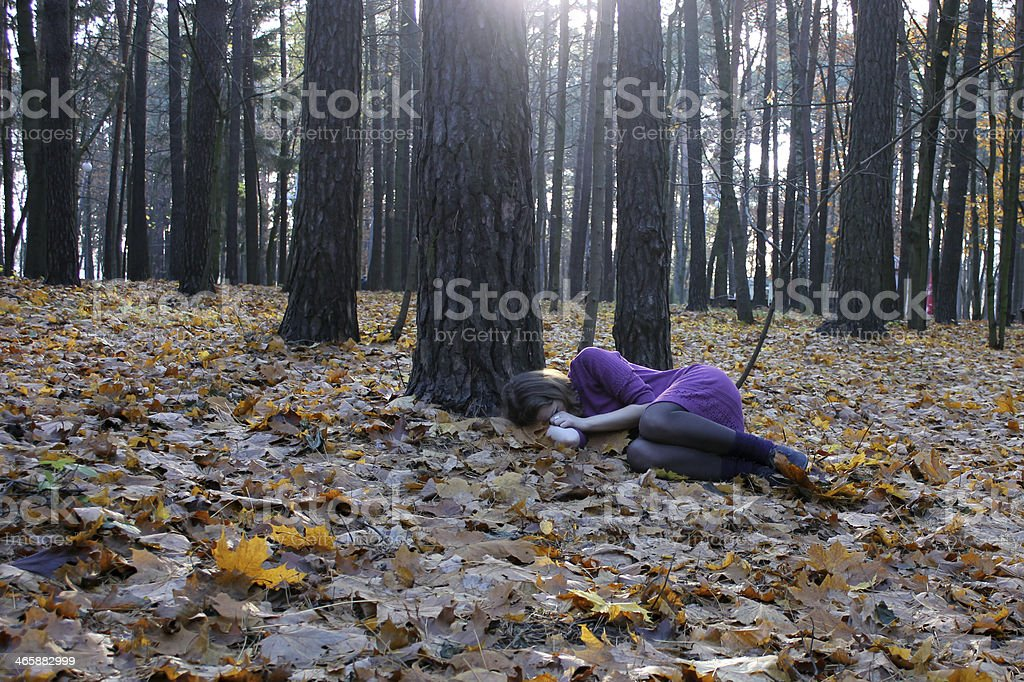 Girl Lying in Woods stock photo