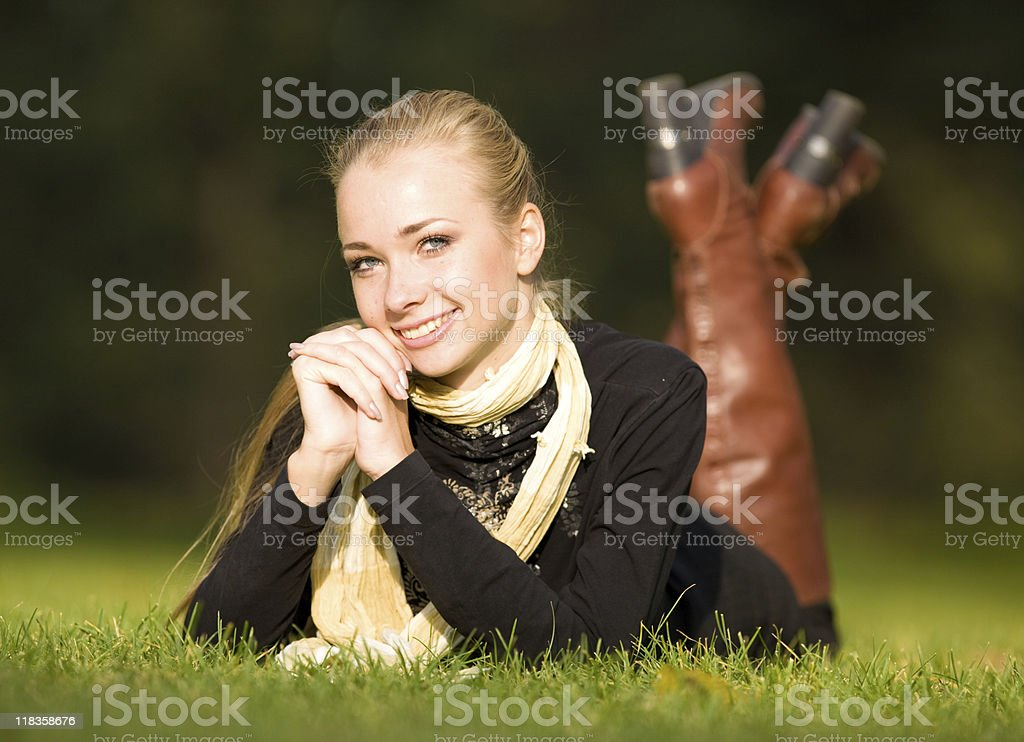 girl lying on the grass royalty-free stock photo