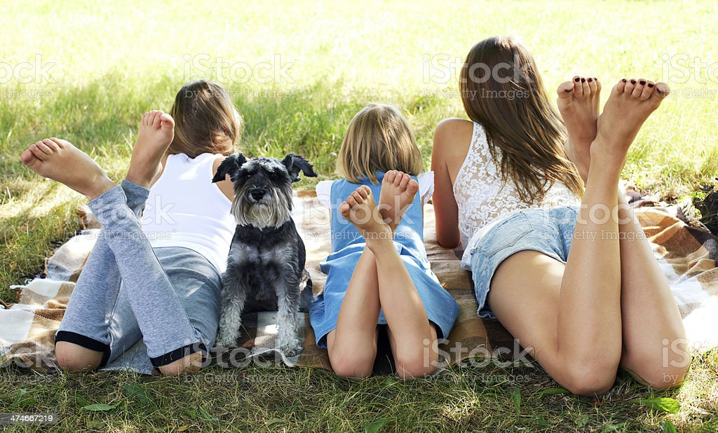 girl lying on the grass with a dog stock photo