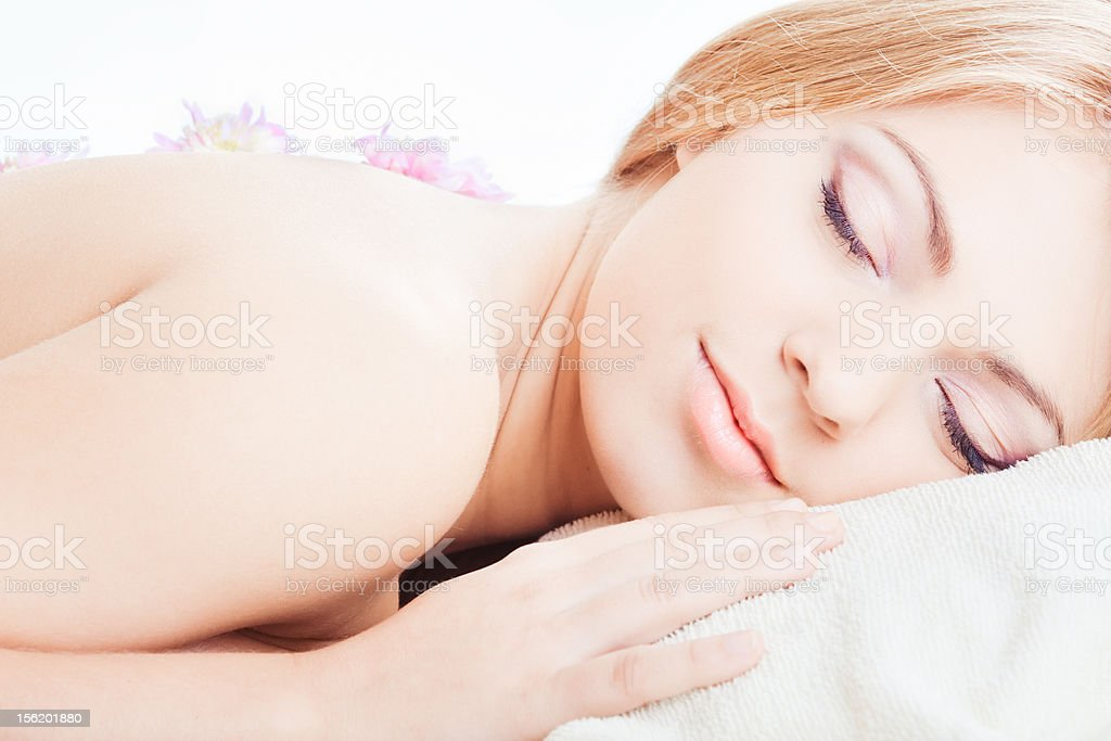 Girl lying with closed eyes royalty-free stock photo