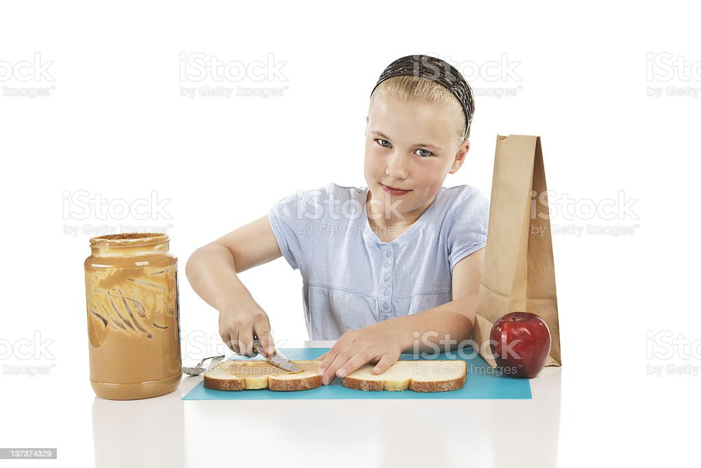 Girl Making a Sandwich royalty-free stock photo