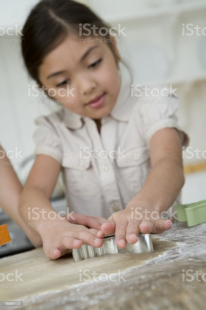 A girl making cookies stock photo