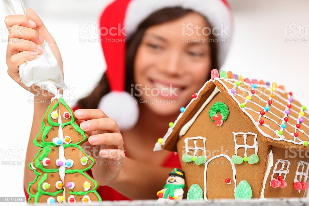 girl making gingerbread house royalty-free stock photo